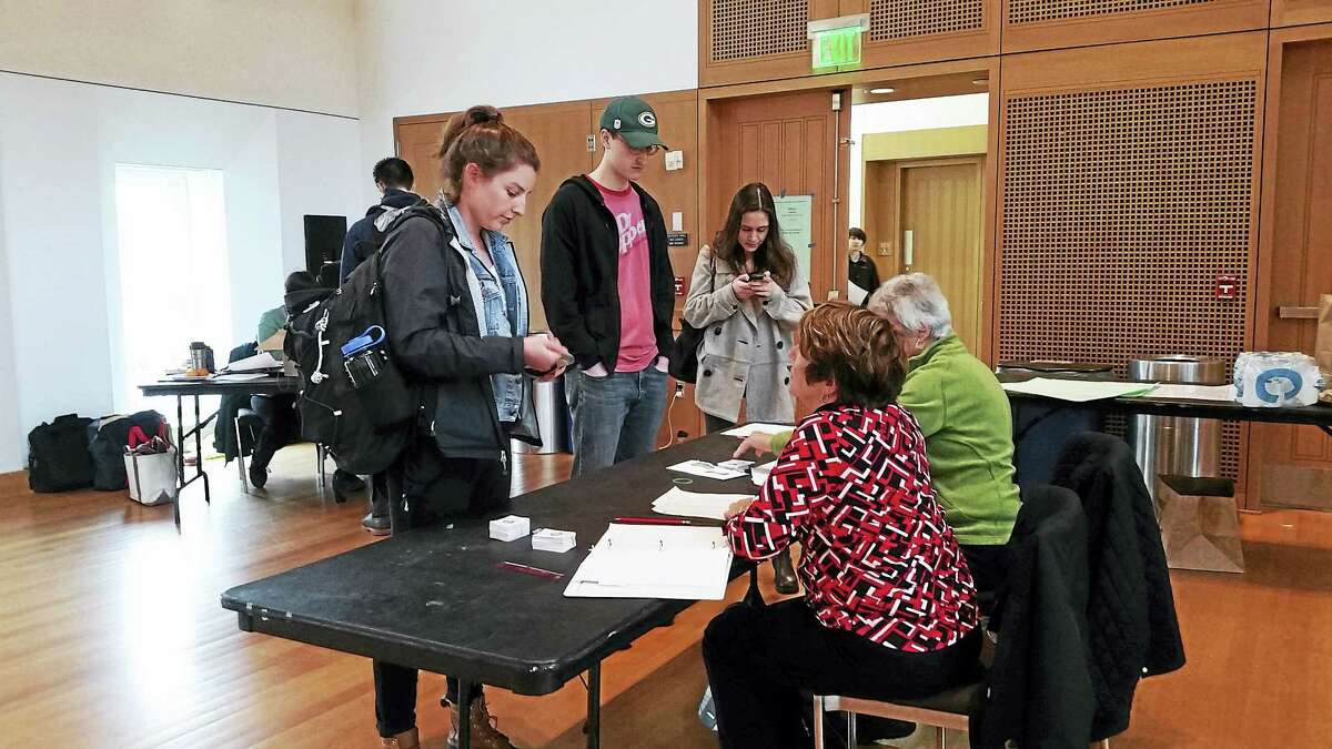 Wesleyan University students vote Tuesday at Beckham Hall in Middletown.