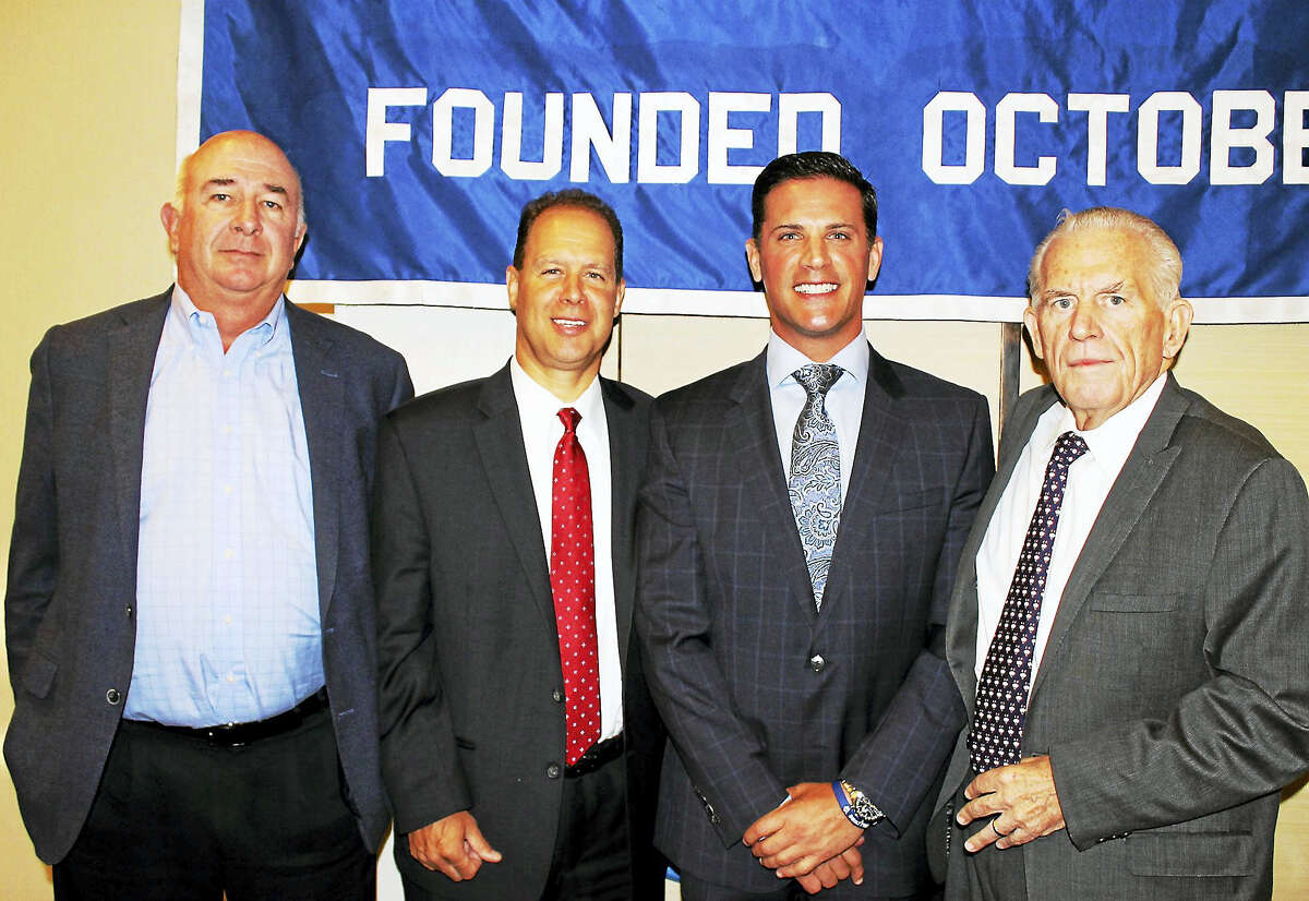 University of Connecticut Football Coach Bob Diaco was guest speaker at the Middlesex Chamber's Member Breakfast Aug. 25. From left are: regional sales representative of People's United Insurance Agency Kevin Foster, President of People's United Bank for Northern Connecticut Michael J. Casparino, UConn Football Coach Bob Diaco and President of the Middlesex County Chamber of Commerce Larry McHugh.