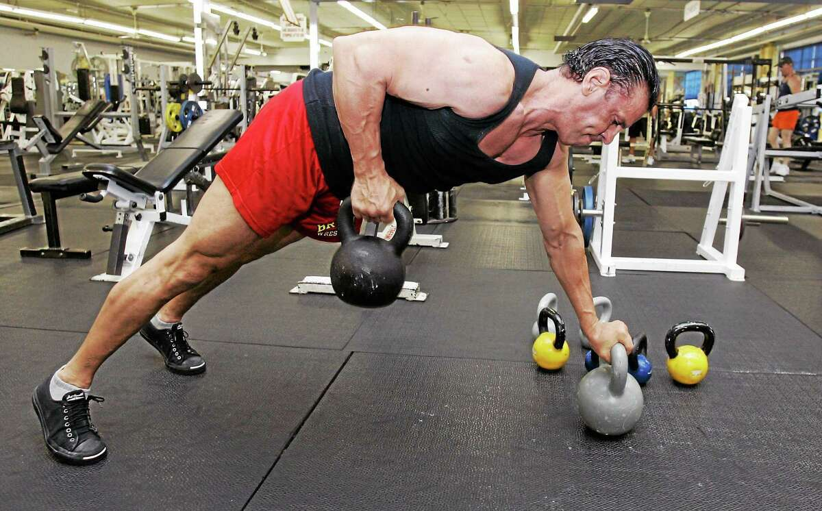 Bob Bonham, owner of Strong and Shapely Gym, works out with kettlebells at his gym in East Rutherford, N.J., in this 2008 photo.