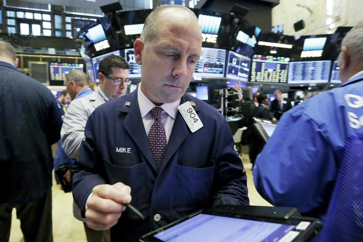 Trader Michael Urkonis works on the floor of the New York Stock Exchange Monday.