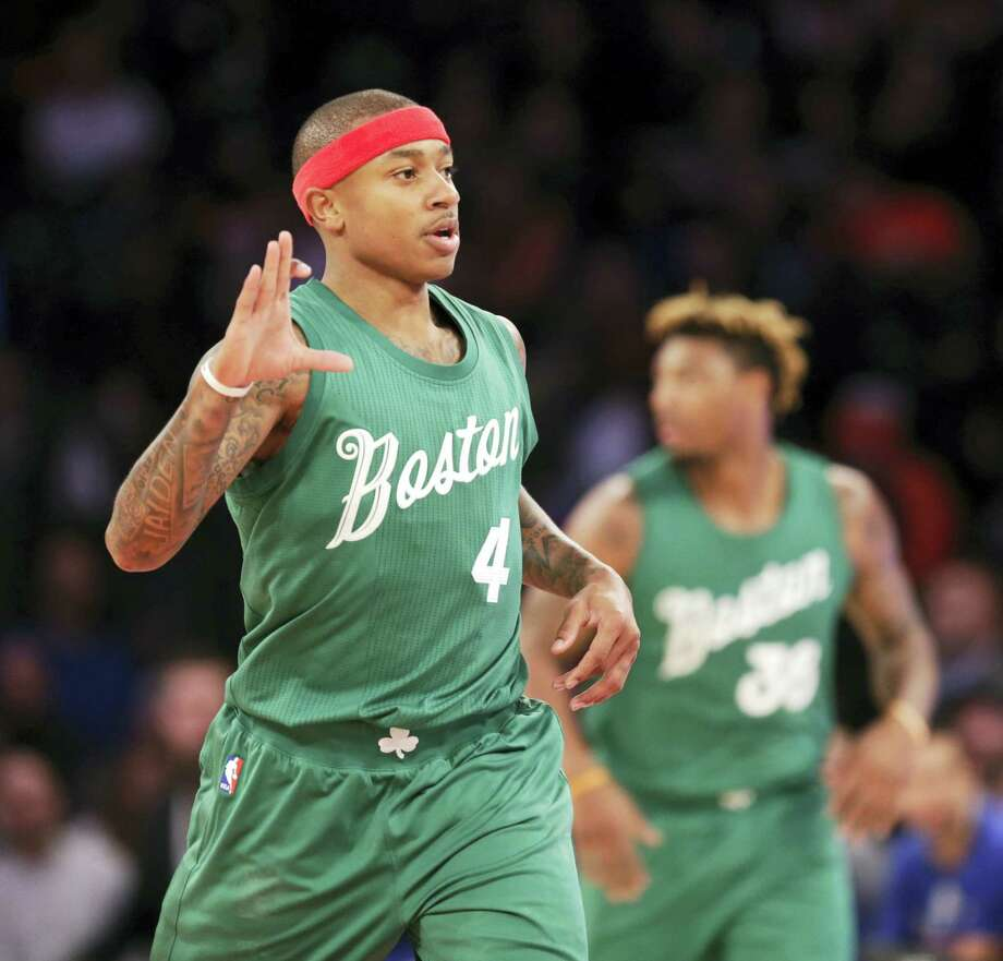 Boston Celtics' Isaiah Thomas reacts after sinking a three-point basket during the first half of the NBA basketball game against the Boston Celtics, Sunday, Dec. 25, 2016 in New York. (AP Photo/Seth Wenig) Photo: AP / Copyright 2016 The Associated Press. All rights reserved.