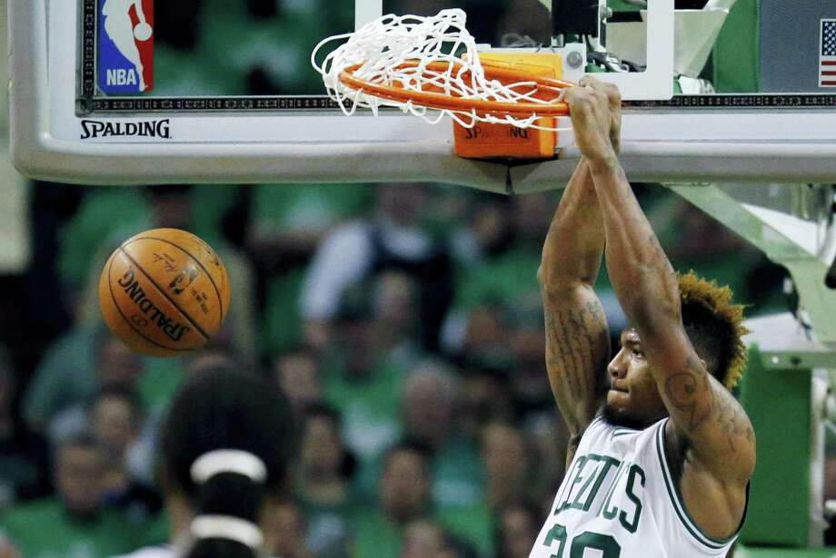 Boston Celtics' Marcus Smart dunks during the fourth quarter in game 4 of a first-round NBA basketball playoff series against the Atlanta Hawks in Boston, Sunday, April, 24, 2016. The Celtics won 104-95 in overtime. (AP Photo/Michael Dwyer) Photo: AP / AP