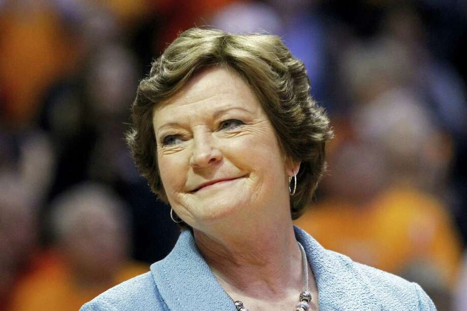 In this Jan. 28, 2013 photo, former Tennessee women's basketball coach Pat Summitt smiles as a banner is raised in her honor before the team's NCAA college basketball game against Notre Dame in Knoxville, Tenn. Photo: AP Photo/Wade Payne, File  / AP2013