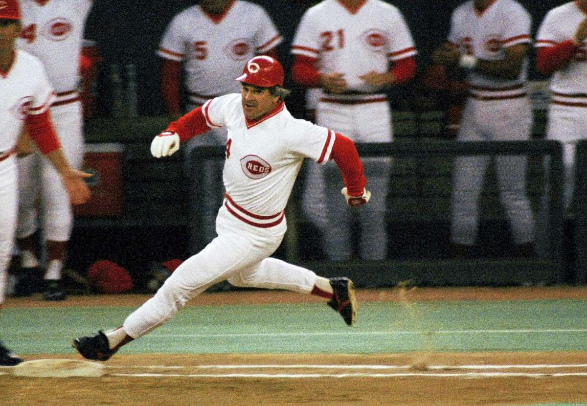 In this Sept. 11, 1985photo, Cincinnati Reds' Pete Rose rounds first base after hitting a single to break Ty Cobbs' hitting record during a baseball game at Riverfront Stadium in Cincinnati.