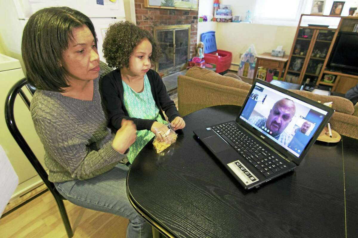 Sharon and Blair Giammarco listen to Arnold during a Skype conversation at their home in Niantic. They frequently use Skype to stay in touch while legal efforts to overturn his deportation continue. Tony Bacewicz Photo.