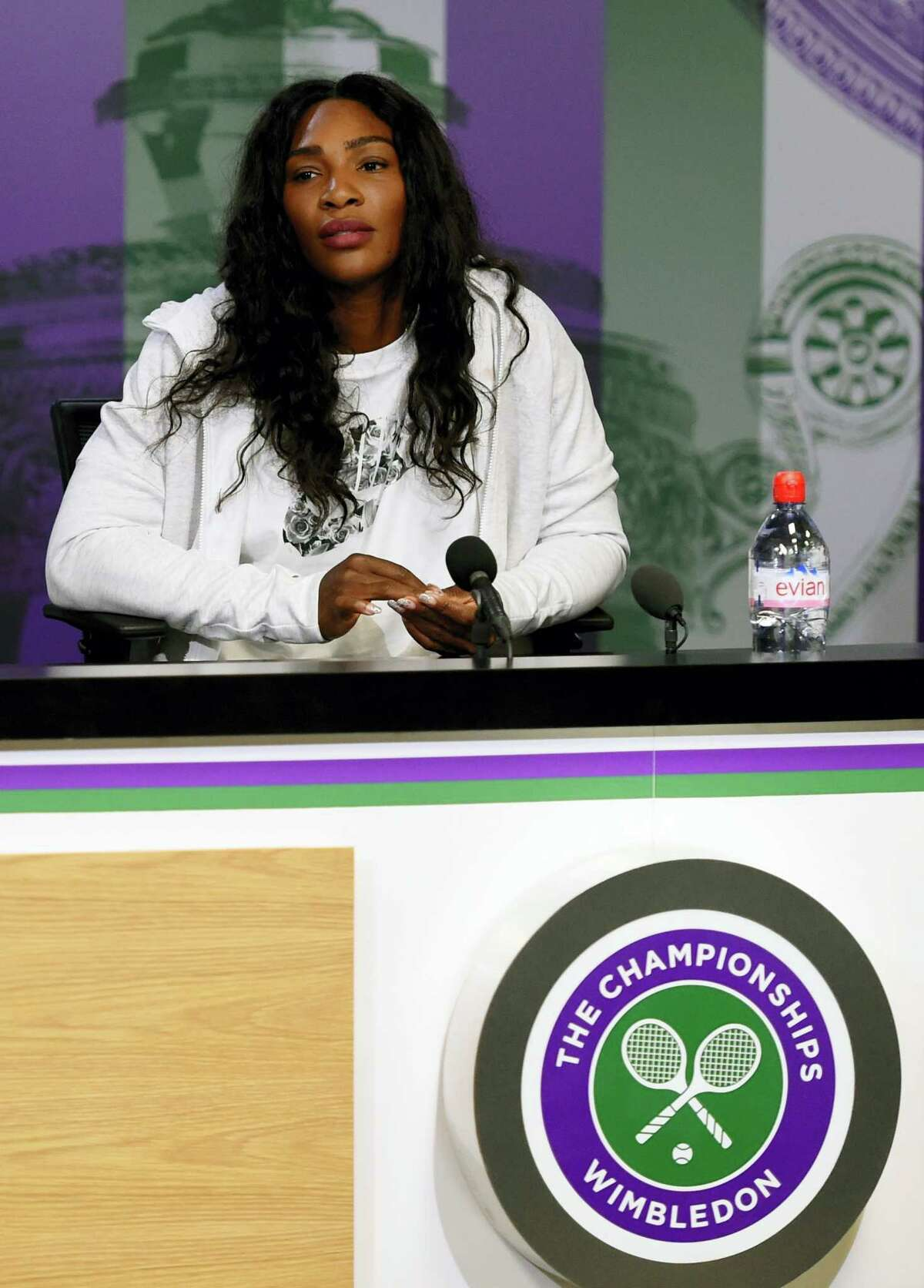 Serena Williams answers questions at a press conference at The All England Lawn Tennis Club on Sunday.