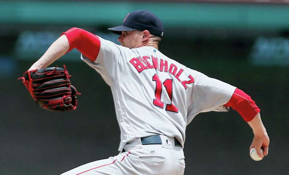 Red Sox starting pitcher Clay Buchholz throws during the first inning on Sunday. Photo: Brandon Wade — The Associated Press  / FR168019 AP