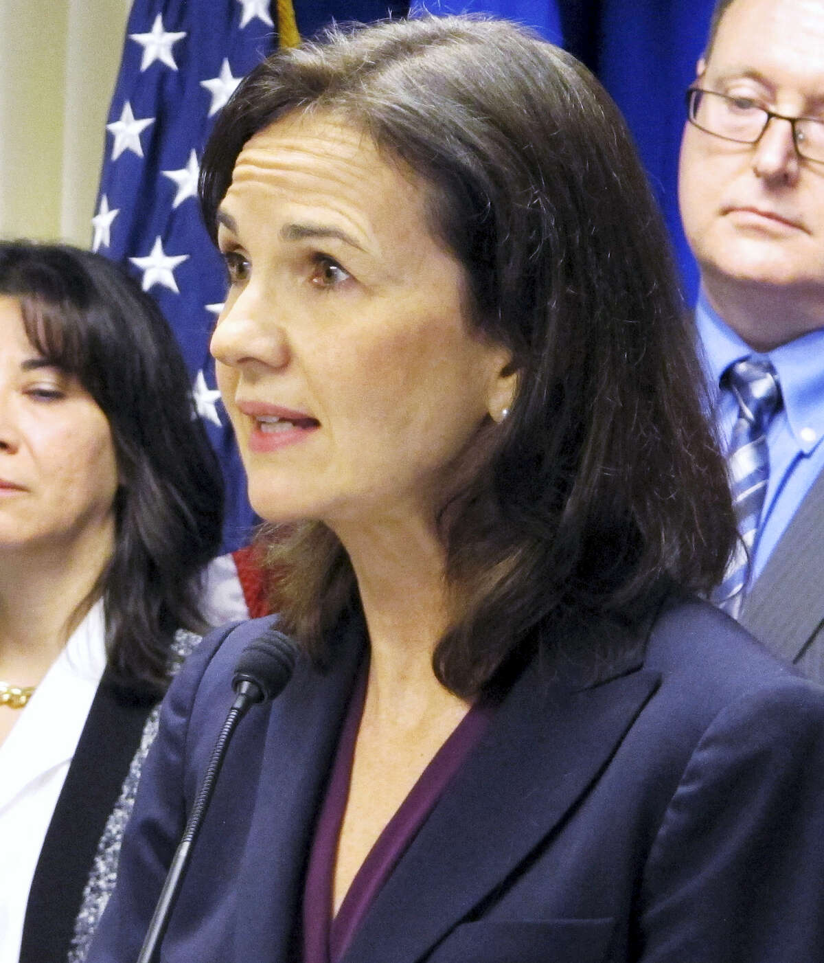 In this file photo, Deirdre Daly, U.S. attorney for Connecticut, stands with other federal officials while announcing a new public corruption task force in New Haven, Conn. Daly is facing an uncertain job future as the presidency changes hands from one political party to another when Donald Trump is sworn into office in January 2017. She has been the top federal prosecutor in the state since 2014, after being nominated by outgoing Democratic President Barack Obama.