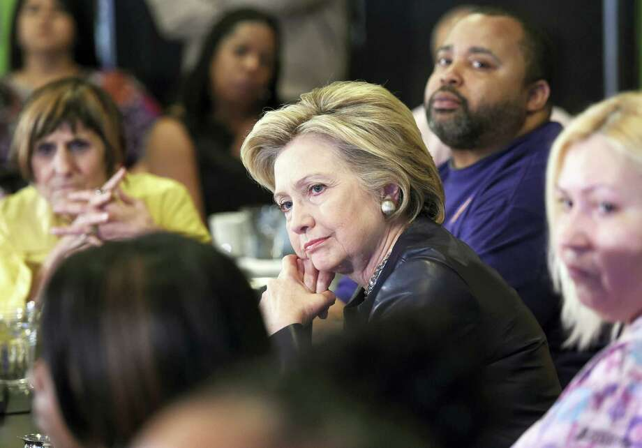 Democratic presidential candidate Hillary Clinton, center, listens to concerns from the audience during a campaign stop at Orangeside on Temple in New Haven, Conn., on April 23, 2016. Photo: Arnold Gold — New Haven Register Via AP  / New Haven Register