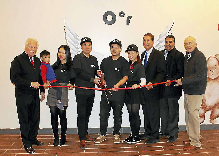 0 degree Inc, a Thai-style ice cream shop, recently held a grand opening at 312 Main St. From left, Middletown Small Business Development Director Paul Dodge, Kelly Wang, co-owner Ivan Lin, Keith Zheng, co-owner Ling Lin, Councilman Tom Serra, building owner Steve Ramchandani and Middlesex County Chamber of Commerce President Larry McHugh. Photo: Contributed Photo