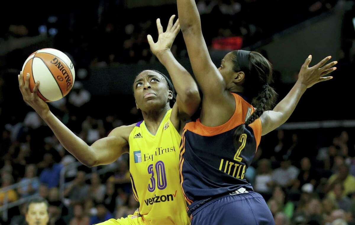 Sparks forward Nneka Ogwumike, left, shoots over Sun forward Camille Little during the second half on Sunday.