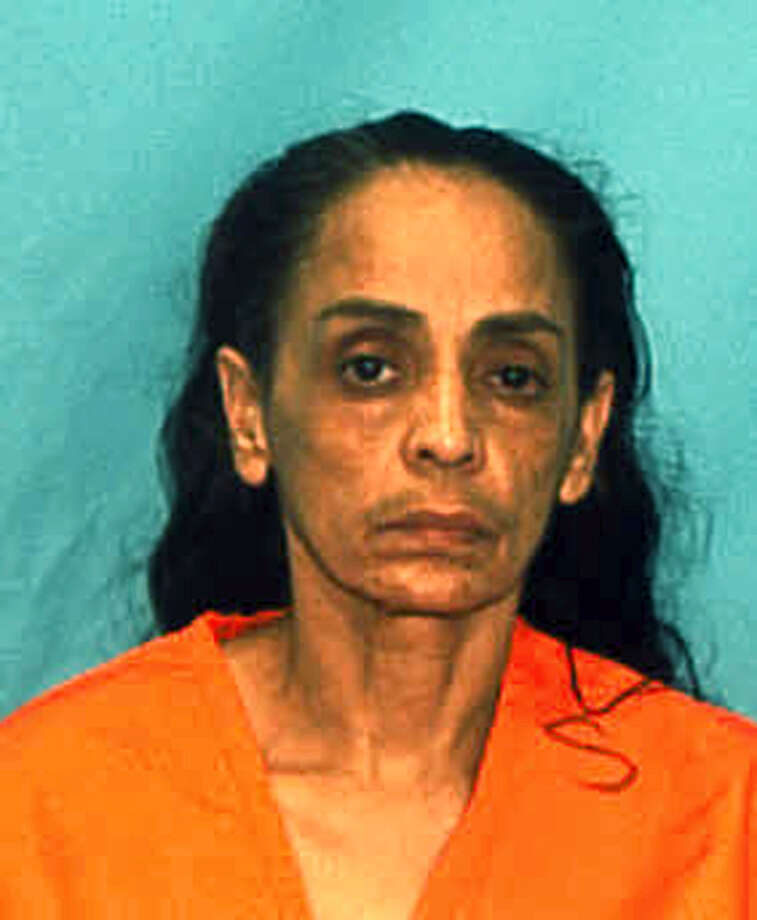 "In this undated arrest photo made available by the Florida Department of Law Enforcement shows Ana Maria Cardona. The murder conviction and death sentence imposed on Cardona for killing her young son known as ""Baby Lollipops"" in 1990, have been thrown out by the state Supreme Court in Tallahassee, Fla., Thursday, Feb. 18, 2016. The decision means that Cardona is likely to face a new trial. Photo: Florida Department Of Law Enforcement Via AP   / Florida Department of Law Enforcement"