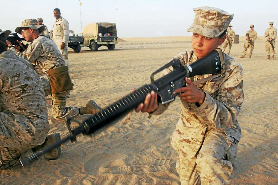 (Photo courtesy U.S. Marine Corps)Cpl. Laura Buckingham, a Eureka, Calif., native, and field radio operator with the 22nd Marine Expeditionary Unit (Special Operations Capable) communications section practices engaging targets while kneeling at a remote shooting range outside Camp Buehring, Kuwait. Photo: Handout / Handout