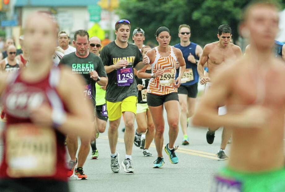 Runners take to the streets in Cromwell for the 5K at Travelers Championship race. Photo: File Photo