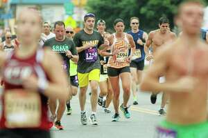 Runners take to the streets Saturday in Cromwell for the 5K at Travelers Championship race.
