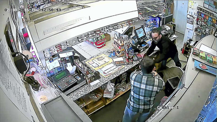 This video surveillance still provided by Middletown police shows the man they say robbed the Gulf Gas Station on South Main Street Thursday at gunpoint. Photo: CONTRIBUTED Photo