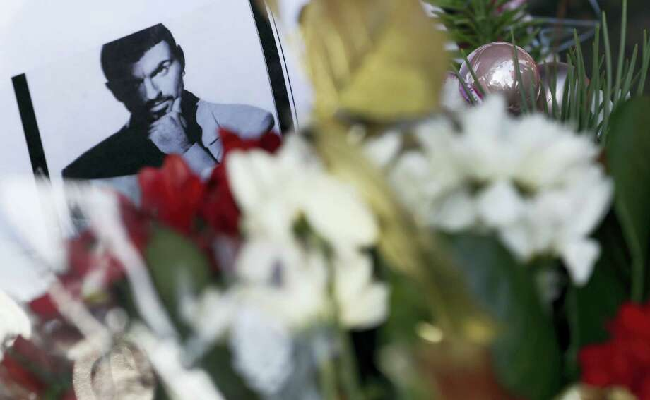 Tributes left outside the home of British musician George Michael in London, Monday. George Michael, who rocketed to stardom with WHAM! and went on to enjoy a long and celebrated solo career lined with controversies, has died, his publicist said Sunday. He was 53. Photo: Kirsty Wigglesworth — The Associated Press  / Copyright 2016 The Associated Press. All rights reserved.
