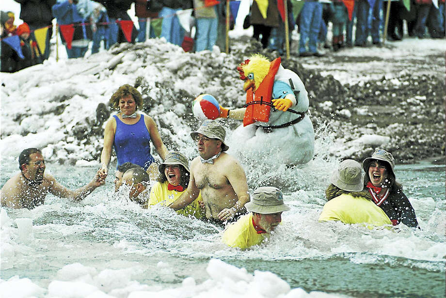 The annual Special Olympics Connecticut Penguin Plunge at the Polish Falcons Club at Crystal Lake in Middletown draws hundreds of brave participants and spectators. Photo: File Photo