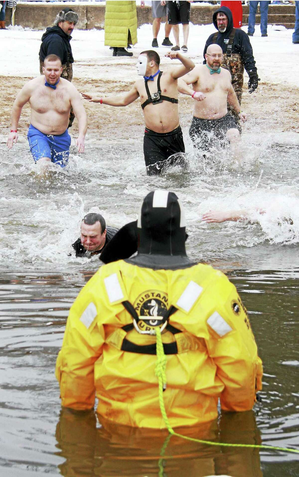 Middletown fire officials in diving gear watch the plunge proceedings to make sure all are safe during the event.