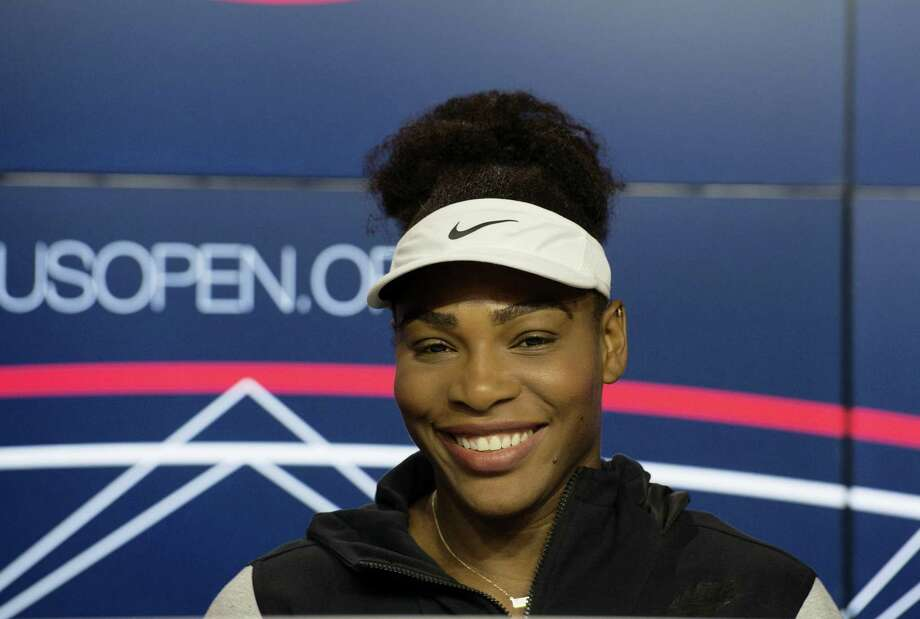 Serena Williams speaks during a media availability for the U.S. Open on Friday. Photo: Bryan R. Smith — The Associated Press  / FR171336 AP