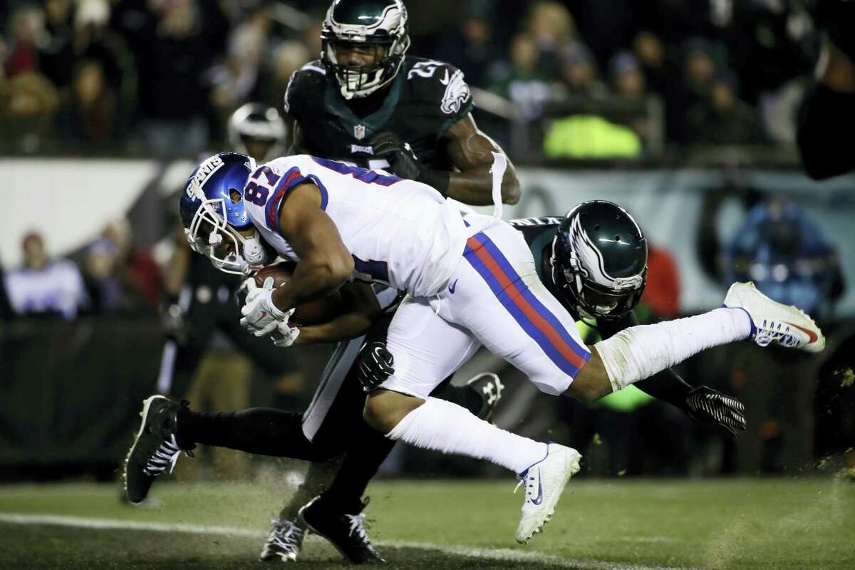 New York Giants' Sterling Shepard (87) scores a touchdown against Philadelphia Eagles' Jaylen Watkins (26) during the first half of an NFL football game Dec. 22, 2016 in Philadelphia.