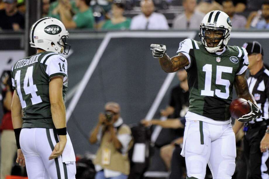 Jets wide receiver Brandon Marshall (15) gestures to quarterback Ryan Fitzpatrick after they scored on a two point conversion during a preseason game against the Falcons. Photo: The Associated Press File Photo  / FR51951 AP