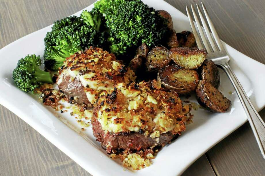 The delicious crust on these petite steaks is made from freshly grated horseradish, mayonnaise, mustard, breadcrumbs and crushed potato chips. Photo: J.M. Hirsch — The Associated Press  / AP