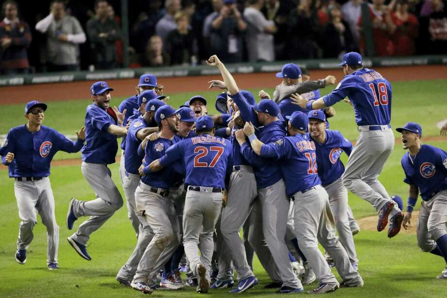 Chicago Cubs celebrate after Game 7 of the Major League Baseball World Series against the Cleveland Indians Thursday, Nov. 3, 2016 in Cleveland. The Cubs won 8-7 in 10 innings to win the series 4-3. Photo: AP Photo/Charlie Riedel  / Copyright 2016 The Associated Press. All rights reserved.