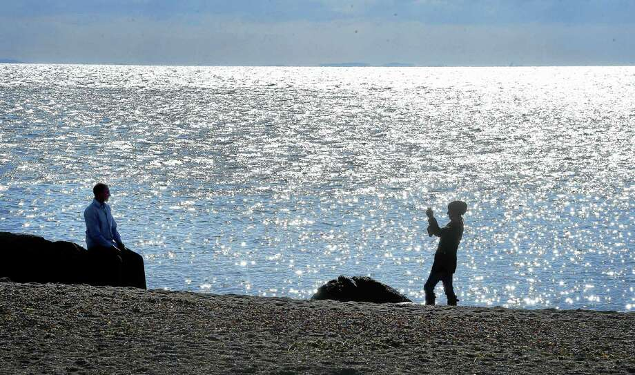 Aaron Saramak (left) of Burlington, Connecticut, has his photograph taken by his life partner, Sandy Bonola, at Meigs Point at Hammonasset Beach State Park in Madison on 1/8/2015. Photo: Arnold Gold — New Haven Register