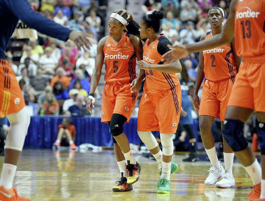 The Sun's Alex Bentley, left, celebrates with teammate Jasmine Thomas during the second half on Friday. Photo: Jessica Hill — The Associated Press  / AP2016