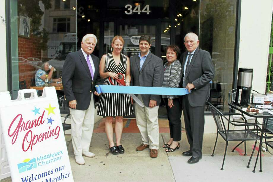Perk On Main, a coffee and crepe house focused on locally grown food and environmentally sustainable coffee, held its grand opening on Main Street June 23. From left are Middletown Small Business Development Counselor Paul Dodge, owner/crepe artist Katie Hughes-Nelson, Middletown Mayor Dan Drew, chairperson of the Downtown Business District Diane Gervais and president of Middlesex County Chamber of Commerce Larry McHugh. Photo: Contributed Photo