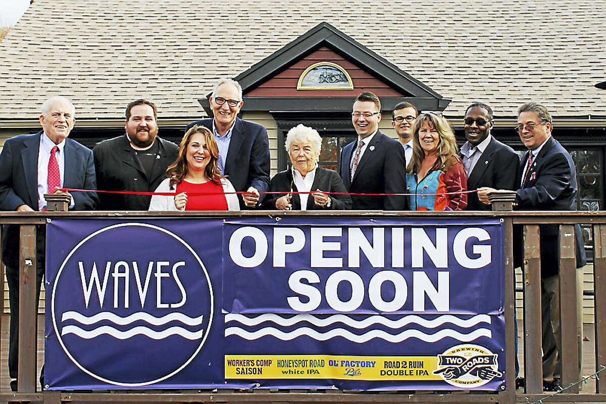 A grand opening was held for WAVES, a nautical-themed American fare restaurant, in East Hampton Oct. 24. Larry McHugh, president of the Middlesex County Chamber of Commerce, joined owner Paul Angelico with staff and local officials, including East Hampton Town Manager Michael Maniscalco, Councilors Peter Brown, Melissa Engel and Kevin Reich and state Sen. Art Linares. Nikki O'Neill, wife of late Gov. William A. O'Neill, cut the ribbon. The O'Neill family once owned a bar at the building when it was known as O'Neill Taproom.