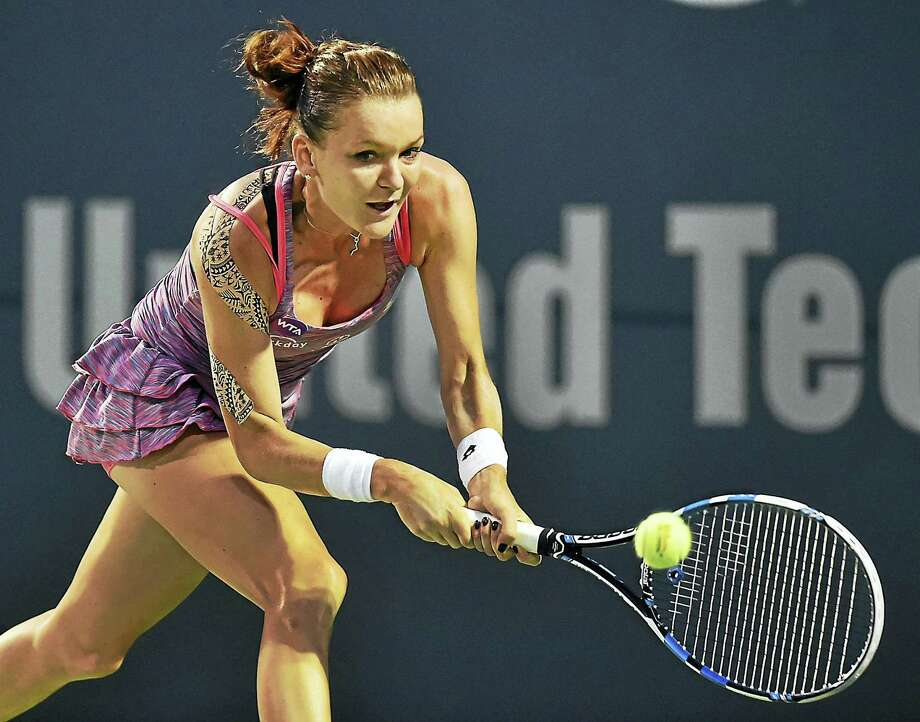 Agnieszka Radwanska defeated two-time defending Connecticut Open champion Petra Kvitova 6-1, 6-1 in the semifinals on Friday night. Photo: Catherine Avalone — Register  / New Haven RegisterThe Middletown Press