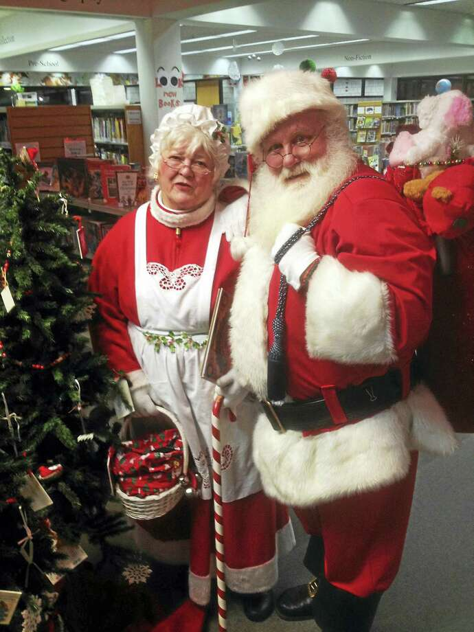 Santa and Mrs. Claus during a recent visit to the Portland Library Photo: Jeff Mill — The Middletown Press