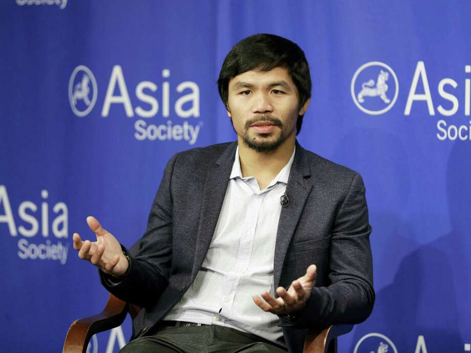 Nike issued a brief statement Wednesday saying it was severing its ties with boxer Manny Pacquiao over his comments about gays. The company said it no longer will have any business dealings with the boxer. Photo: The Associated Press File Photo  / AP