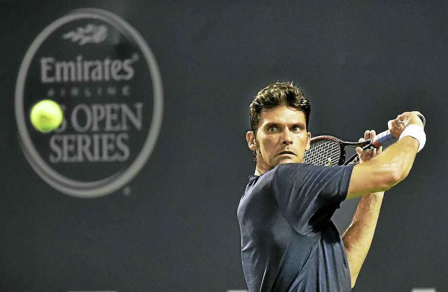 Mark Philippoussis returns a shot against Andy Roddick on Friday. Photo: Catherine Avalone — Register  / New Haven RegisterThe Middletown Press