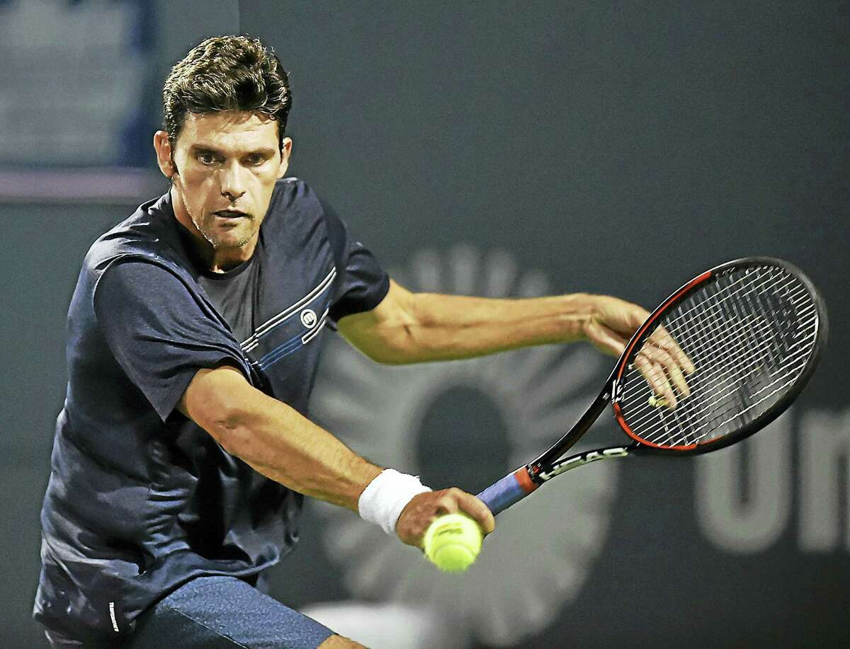 Mark Philippoussis returns a shot against Andy Roddick 6-1 in a PowerShares Series match on Friday.