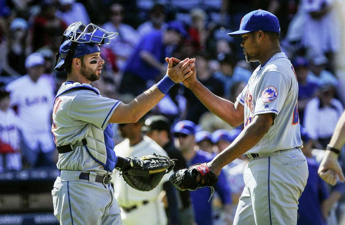 Jeurys Familia, right, and catcher Kevin Plawecki celebrate after Sunday's win.