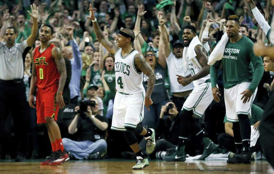 The Celtics' Isaiah Thomas (4) celebrates after hitting a 3-pointer during the fourth quarter against the Hawks on Sunday. Photo: Michael Dwyer — The Associated Press  / Copyright 2016 The Associated Press. All rights reserved. This material may not be published, broadcast, rewritten or redistributed without permission.