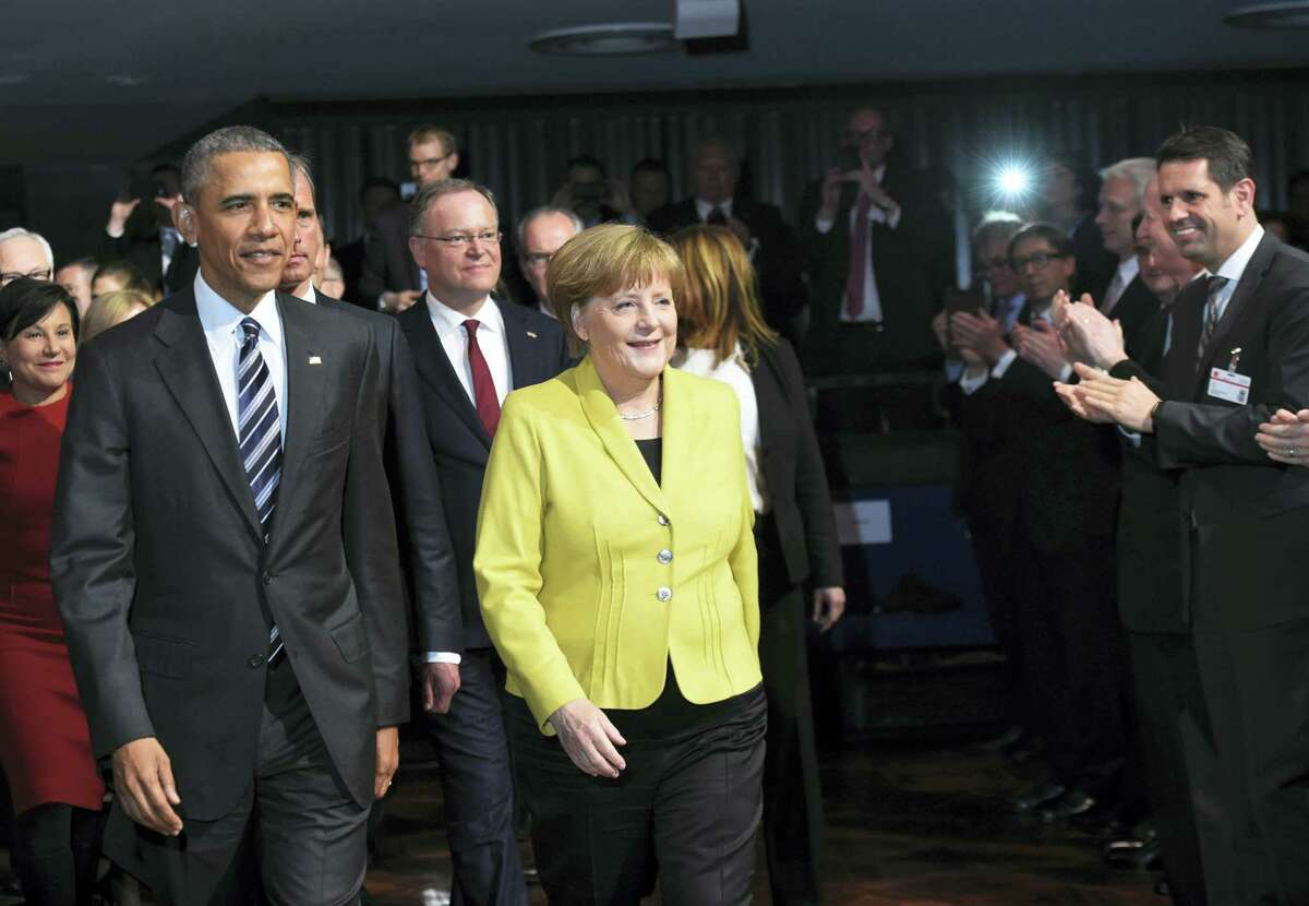 U.S. President Barack Obama, left, and German Chancellor Angela Merkel arrive for the opening of the Hannover Messe industry fair in Hannover, northern Germany on April 24, 2016. Obama is on a two-day official visit to Germany.