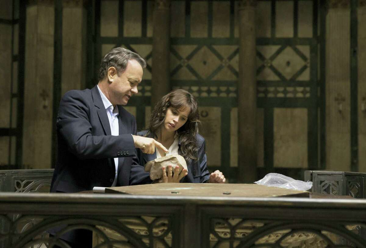 """In this file image released by Sony Pictures, Tom Hanks, left, and Felicity Jones appear in a scene from, """"Inferno."""" Tom Hanks and Ron Howard's latest Dan Brown adaptation, """"Inferno,"""" went up in flames at the weekend box office, allowing Tyler Perry's """"Boo! A Madea Halloween"""" a surprise victory."""