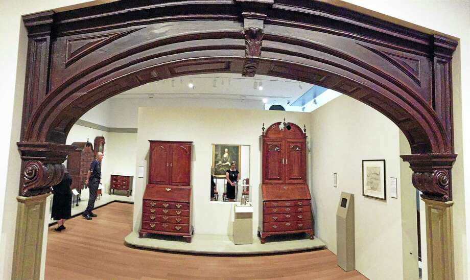 Framed by the archway from the Bannister-Mackaye House (on loan from Winterthur Museum), the fourth-floor gallery space holds the works of skill and craft such as the Christopher Townsend desk and bookcase at right that stands almost 9 feet tall. Photo: Joe Amarante — Register