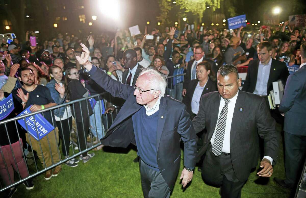 Arnold Gold-New Haven Register Democratic presidential candidate Bernie Sanders waves goodbye to the crowd assembled on the New Haven Green Sunday.
