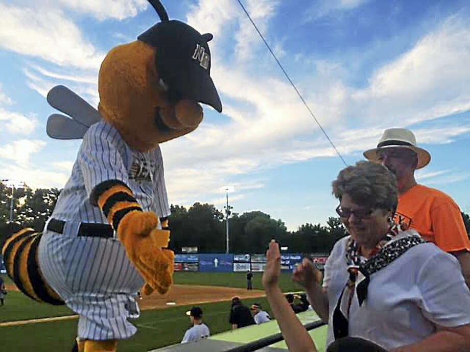 Sting, the mascot for the new independent league New Britain Bees, engages with fans at a recent game. Photo: David Borges — Register