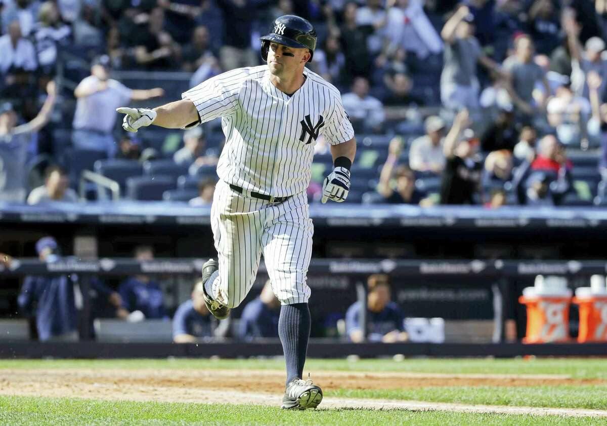 Brett Gardner points to his dugout after hitting a walk-off home run in the ninth inning against the Rays on Saturday in New York. The Yankees won 3-2.