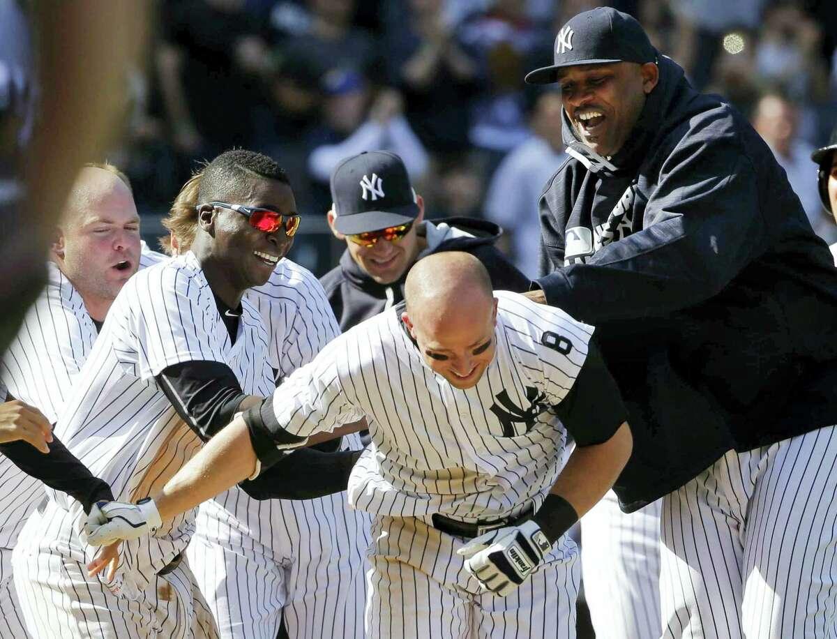 Brett Gardner, center, celebrates with teammates after his game-winning home run.