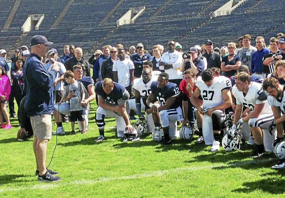 Yale coach Tony Reno speaks to his team on Saturday. Photo: Jim Fuller — Register