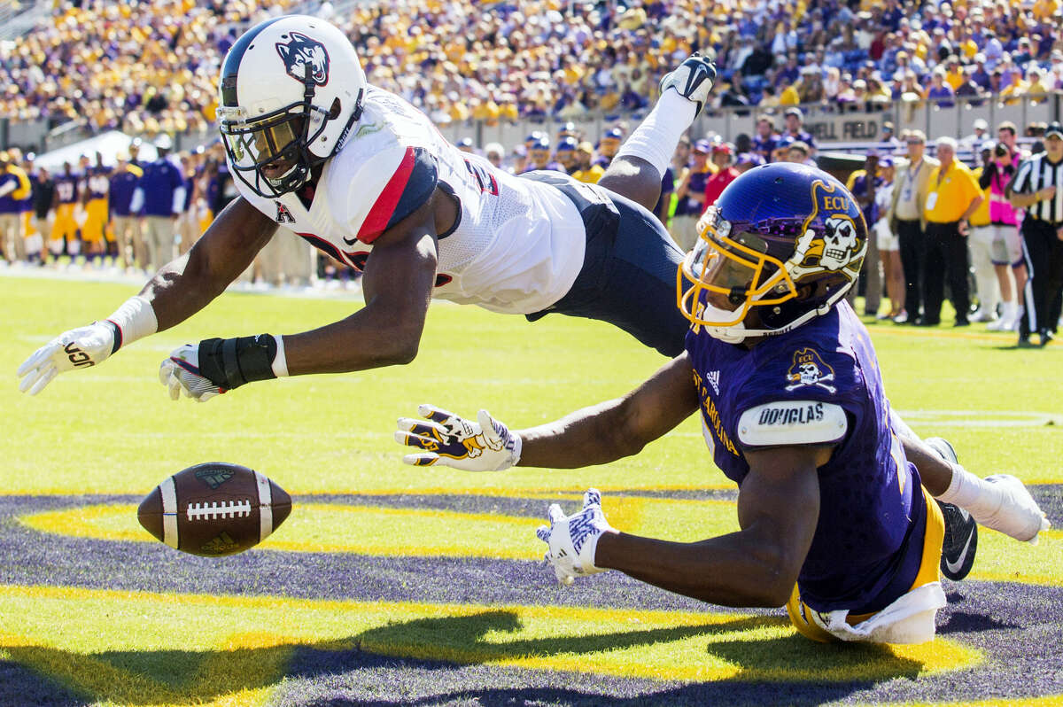 UConn's Obi Melifonwu, left, and East Carolina's Zay Jones attempt to catch a pass in the Pirates' end zone on Saturday in Greenville, N.C.