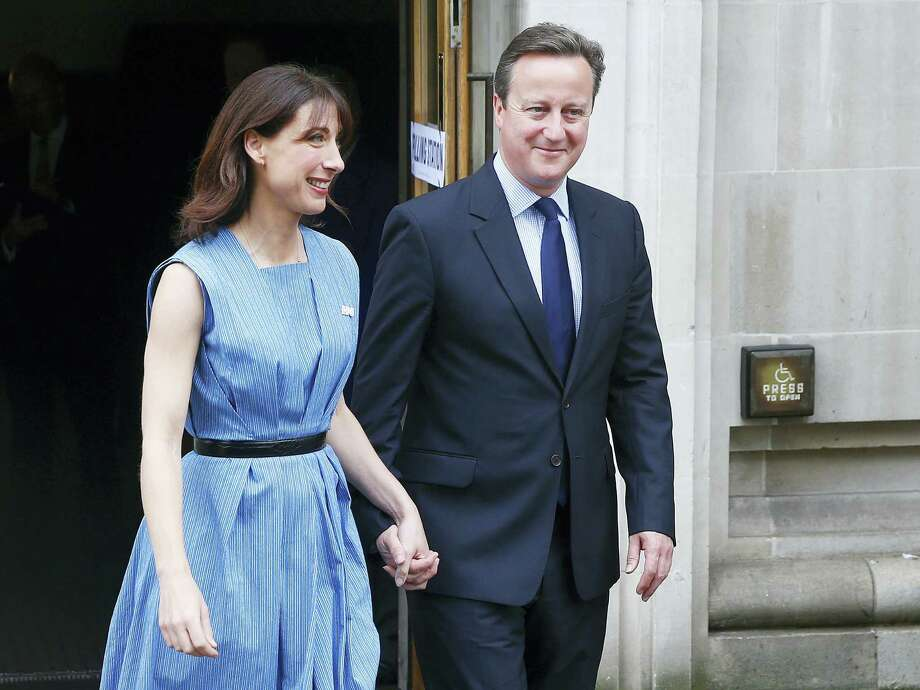 Britain's Prime Minister David Cameron and his wife, Samantha, smiled as they left after voting in the EU referendum in London Thursday. After the results of the vote, Cameron announced his plan to resign. Photo: ASSOCIATED PRESS  / AP