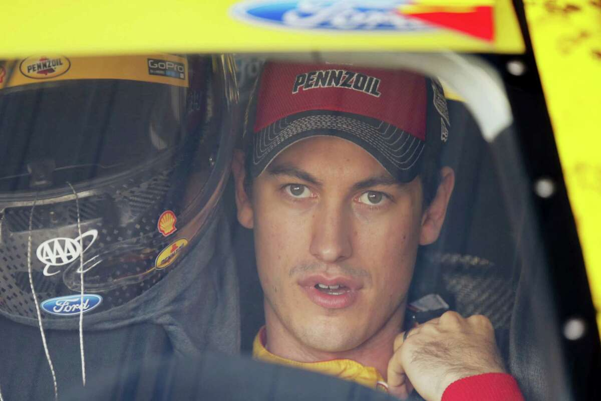 Sprint Cup Series driver Joey Logano (22) prepares for practice for Sunday's race at Martinsville Speedway.